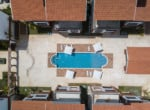Coral Village sky view of swimming pool rendering