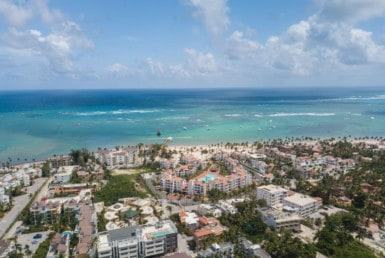 los corales drone aerial photo of beach and apartments